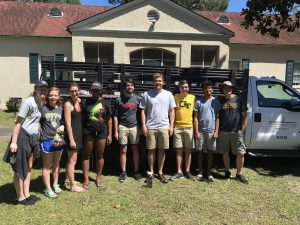 The 2017 REU stduents are ready to take a ride in the back of the Sapelo Island field station's jalopy!